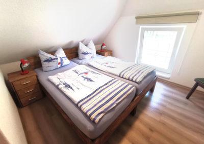 Machen Sie es sich oberen Schlafzimmer mit Doppelbett gemütlich!